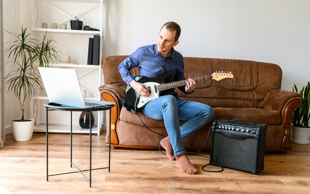 Student Learning Guitar Online